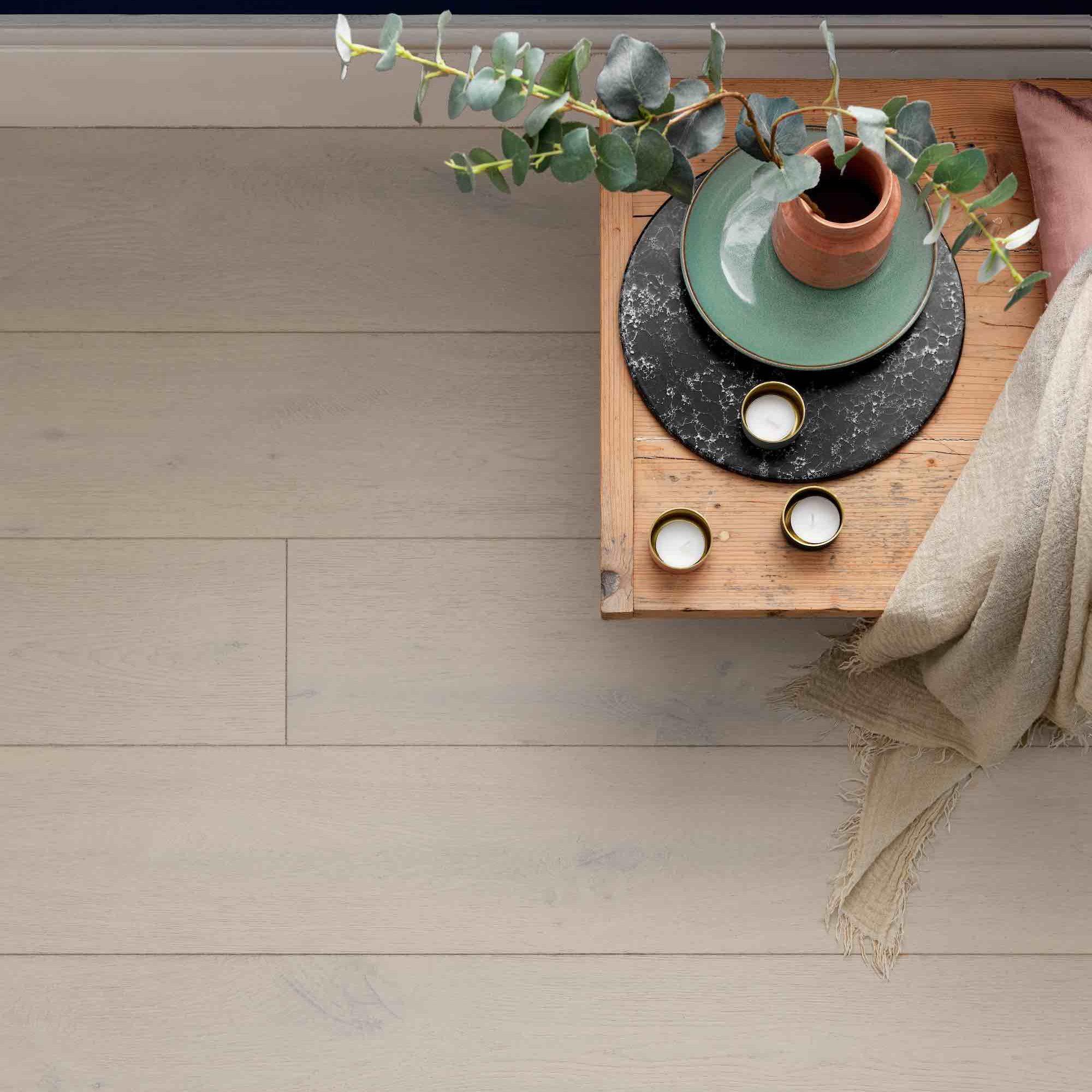 Engineered hardwood flooring in wide planks and white tones
